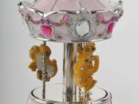 .  Definitely gorgeous Faberge Style revolving Frog