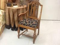 Beautiful accent chair with a black monkey fabric on