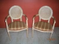 Luxury classic chairs with armrests, cane back and