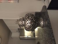 Very cool accent piece. Chrome metal vase / jar with