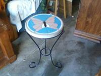 We have an accent table with a concrete top with a