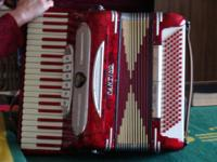 Cantino Accordian with straps and case. Plays