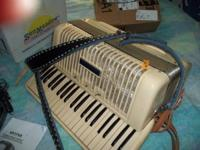 ------A WURLITZER ACCORDIAN-----HAS GOOD BELLOWS-NO AIR