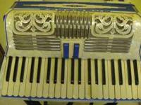 this is a beautiful old accordian. the bellows work