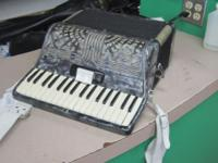 Enrico Rosselli Accordion. $125. Please call  or come