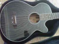This is an Electric Acoustic Base Guitar made by