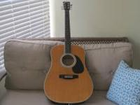 Mint condition acoustic/electric guitar. Works great. I