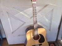 Excellent condition acoustic Fender Squire guitar.
