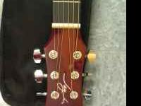 Basically new 3/4 size Jay Turser acoutic guitar. I