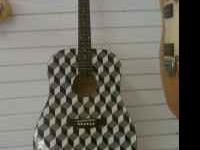 Checkerd like design guitar call  Location: auburndale