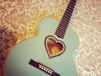 I'm selling my JJ Heart acoustic guitar. It has a teal