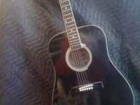 Used, one string missing High gloss black finish. Has
