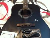 Epiphone Guitar with a capo, a string winder, and a