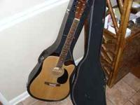 Johnson Acoustic guitar with case. Also comes with a