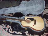 it is an Mitchell acoustic guitar that can be plugged