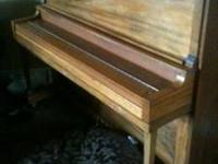 Used piano, dates back to somewhere in the 1900-1930'S.