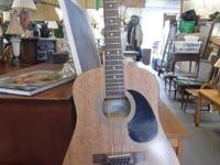 """Raglan"" Acoustic Guitar  12 Strand  This guitar is in"