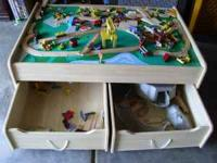 Selling a Play Table with roll out drawers-- used for