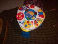 Activity table with adjustable heights. It has a