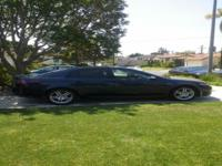 Acura TL 3.2L, it has Bluetooth, XM Radio with CD/Aux