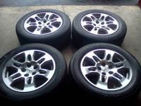 I have a nice set of Acura wheels with tires, removed