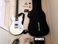 Guitar comes with: - mini amp and cables - case -