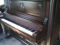 Nice Woodwork on this upright piano. Has real Ivory