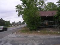 corner lot on FM943 and HWY 59 structure in requirement