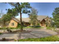 This charming French Country custom home offers