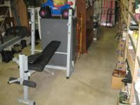 Adjustable Position weight bench with leg and biceps