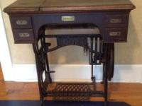 The beautiful Adler treadle sewing machine and cabinet