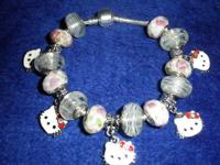 Pink bead bracelet with charms and beads. Adorable