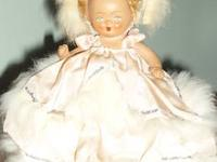 Truly adorable little all composition/bisque doll in