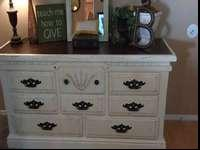 Adorable updated dresser/entertainment stand. Painted a