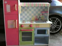 So cute, pink wooden toy kitchen, like Pottery Barn. A