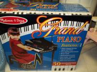 Every child would love this little piano. It is a