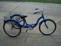 blue adult tricycle ridden very little. bought 2 years