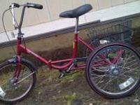 Like new, less than 5 miles, folding tricycle with