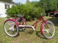 This a trailmate ez roll regal adult trike. it is