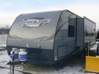 This Aerolight 25 foot Travel Trailer Sleeps four. It