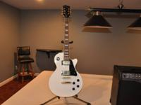 Beautiful white Agile AL-2000 guitar - does not have a