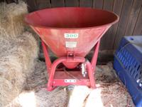 For sale is an Agrex seed or fertilizer spreader.