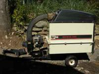 For sale is a used Agri-Fab Mow-N-Vac in good