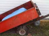 10CU.FT DUMP LAWN TRAILOR.Needs new tubes for tires.You