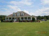 RESIDENCE AND 45 ACRES AT 7900 TANNER WILLIAMS ROAD IN