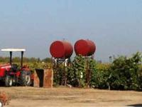 Agricultural fuel tank on stand. Can be used to buy