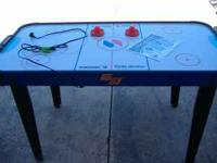 Air Hockey table. Used very little. Still like new.