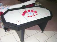Hours of fun for the kids with this air hockey table