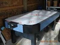 Air Hockey Table. Very sturdy not the cheap kind. Need