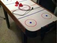 Halex kid's air hockey table. Works fine, just don't